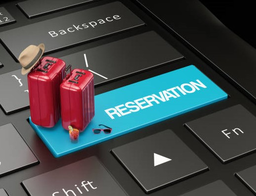Online Booking Concept with Suitcases and Laptop. 3D Render