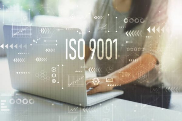 ISO 9001 with woman using her laptop in her home office