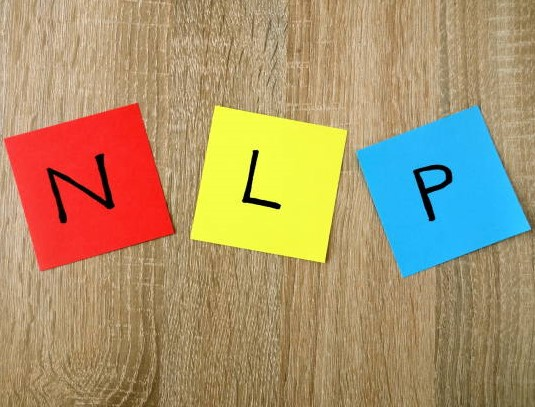 NLP – Neuro Linguistic Programming sign on colorful sticky notes