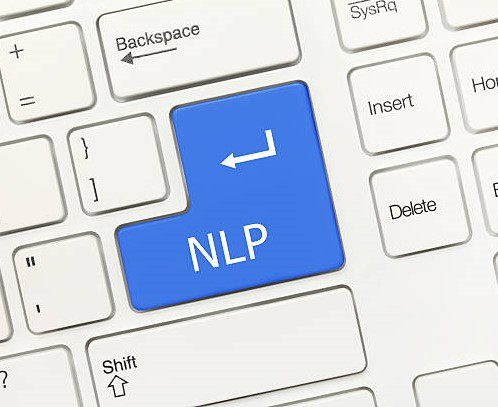 Close-up view on white conceptual keyboard – NLP (blue key)