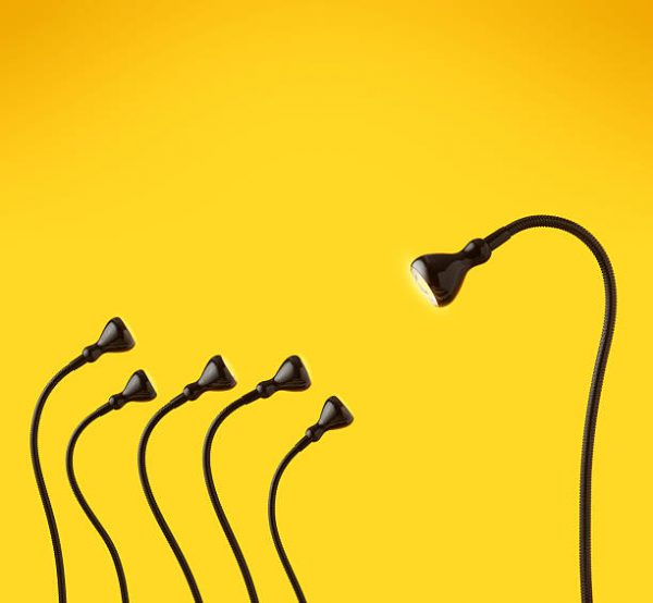 There is six desk lamps on yellow background as characters.