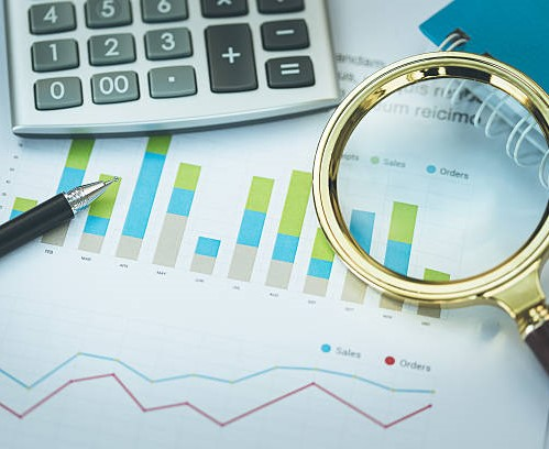 Business and Finance Concept: Analyzing Financial Report