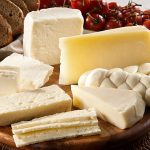 Different dairy products with bread and tomato